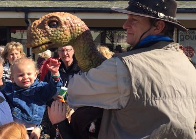 Baby Dinosaur Brontosaurus attracting a crowd