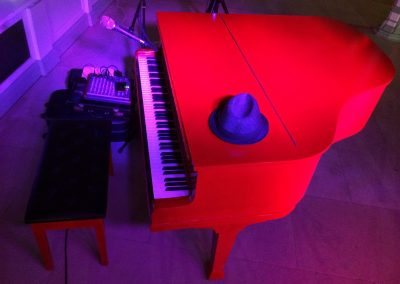 Image of Tim Owen and the red piano- Isle of Gladstone