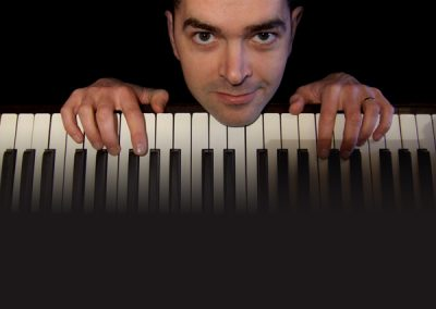 Image of Mike Taylor on the keys for Camscott Leisure
