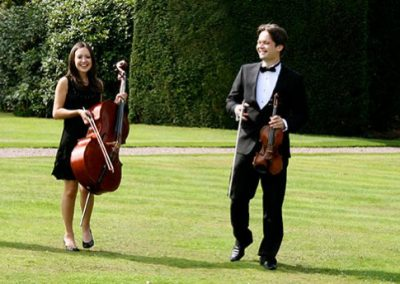Image of the Pachebel String Quartet on the venue lawn