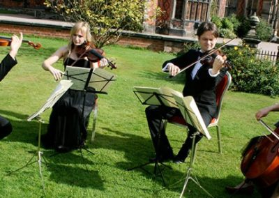 Image of Pachebel String Quartet perfoming for Camscott Leisure on the venue lawn