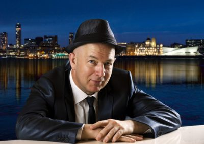 close up image of Simon Brown the pianist at the waterfront