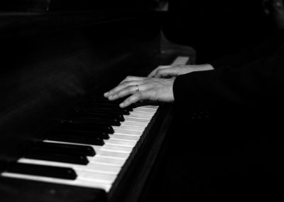 Mike Taylor is hands on with a black piano