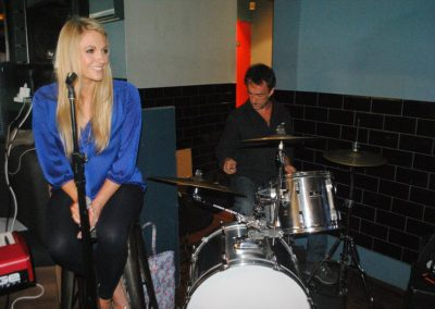 Image of Pianist Jennie and a drummer in rehearsal