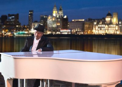 Waterfront image with Simon Brown the pianist